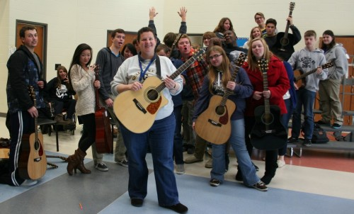 Ms. Floy Latham rocks out with her guitar class. Photo by Natalie Herson