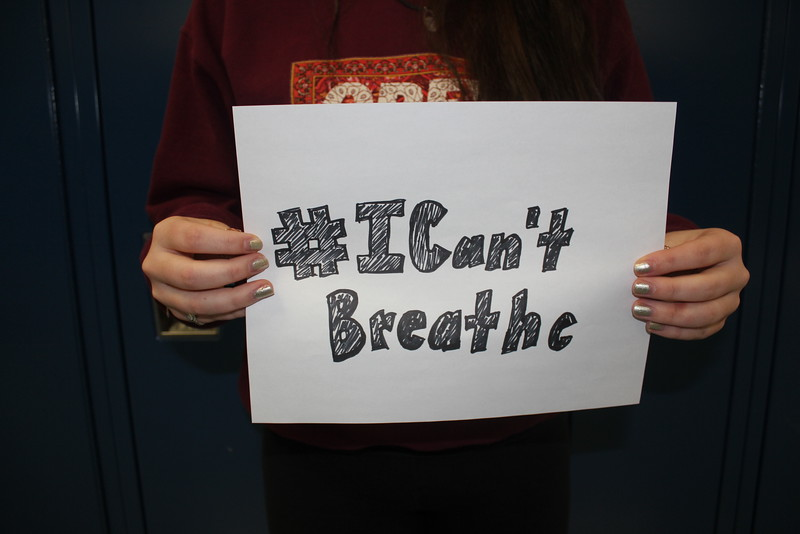 """I Can't Breathe"" has become a staple chant in demonstrations protesting the death of Eric Garner, along with phrases inspired by Michael Brown's death like ""Hands up, don't shoot"" and ""No justice, no peace."" The numerous deaths of unarmed black men in 2014 have sparked a national dialogue about racial inequality and racial injustice.  Photo by Natalie Herson."