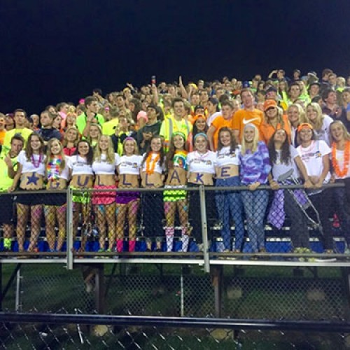Gull Lake student section gets hype during the neon/rave themed game against Loy Norrix.   GL won the game, 29-27.  Photo courtesy of Mili Renuart.