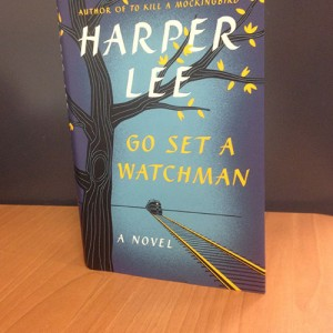 Go Set a Watchman cover shows a black tree with sparse yellow leaves and a train approaching from the distance. Photo by Maiya Wimbley