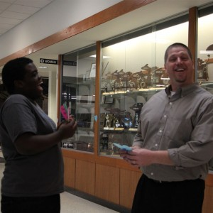 Sophomore Keyshawn Wilson presents Principal Eastman with a paper heart as a part of GLHS Kindness Week. Photo by Emily Koenig