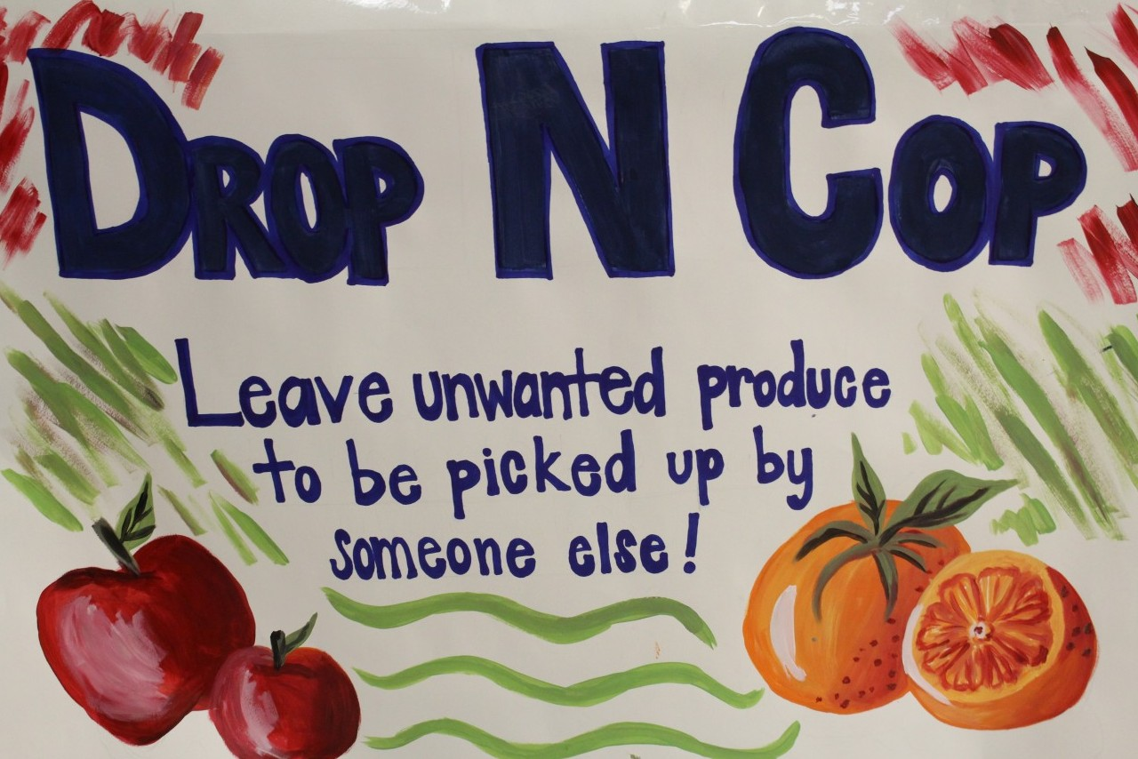 The Drop-N-Cop Food Table set up by in the cafeteria for students to leave their unwanted produce. Photo by Maddie Hough