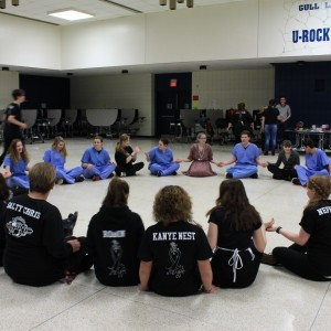 The PAC team prepares and does warm-ups together before performing The Gift lat week. Photo by Reagan Tustin.