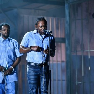 Kendrick Lamar performing at the 2016 Grammy Awards, representing incarcerated African Americans. Photo courtesy of huffingtonpost.ca