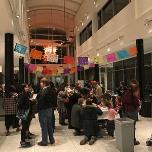 The Kalamazoo Institute of Art decorated for the celebration of Dia de los Muertos. The banners hanging from the ceiling are a common decoration for the holiday. Photo taken by Courtney Pedersen.