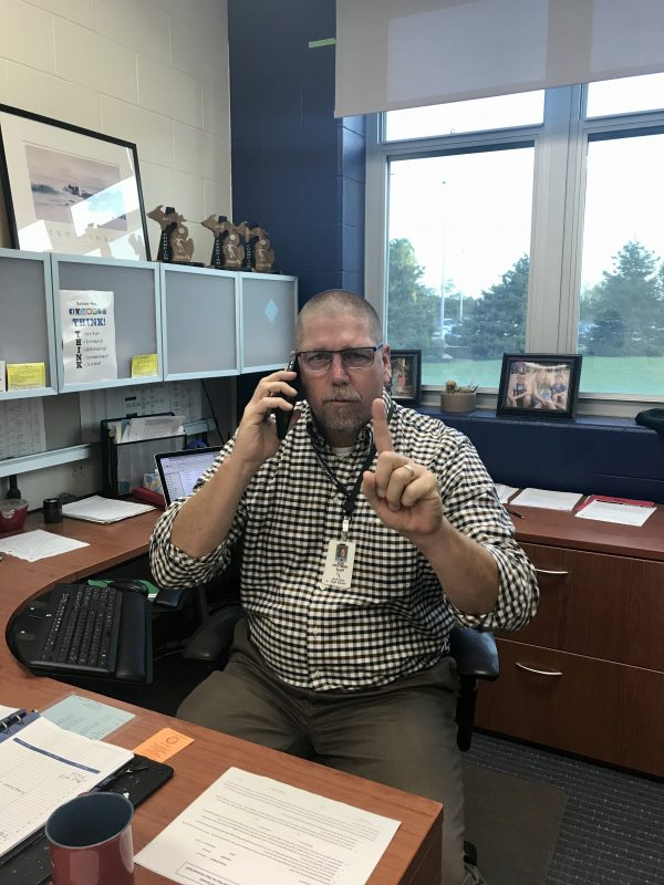 Don Eastman, the principal of Gull Lake High School, indicating to not use your phone in class.
